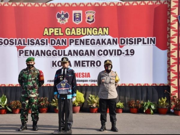 Sosialisasi dan Penegakan Disiplin Protokol Kesehatan dalam Menghadapi Era Normal Covid-19, Walikota Metro Pairin Gelar Apel Gabungan.